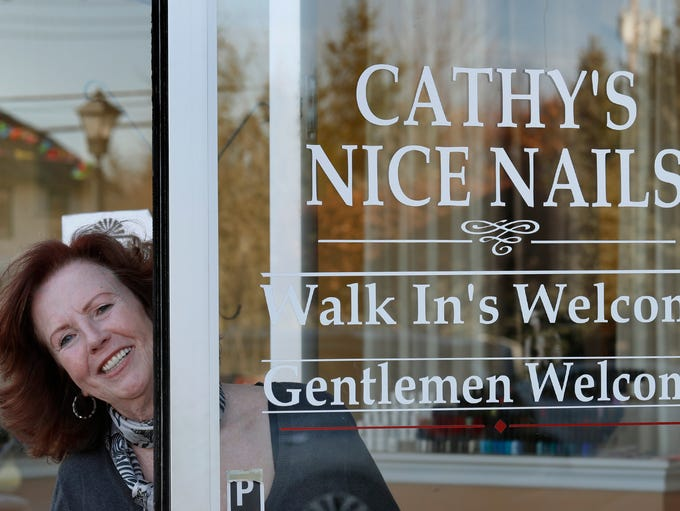Cathy Serrantonio, owner of Cathy's Nice Nails at front