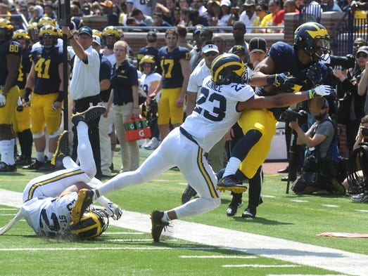 University of Michigan receiver Tarik Black is tackled