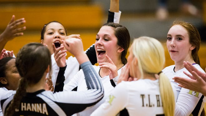 T.L. Hanna's Hannah Burnette, center, celebrates with her teammates after defeating J.L. Mann on Tuesday.