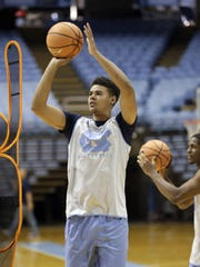 Cameron Johnson shoots during practice following UNC's