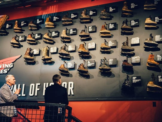 armer Eric Tildequist's barn shoes hang (top right) on the Wall of Honor at the Red Wing Shoe Company. The wall shares not only the boots of skilled laborers but their stories as well.