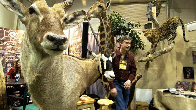 Taxidermist David Botts of Ogden, Utah is surrounded hsi work at the Safari Club International Convention on Wednesday, Jan. 18, 2006. Photo by David B. Parker.