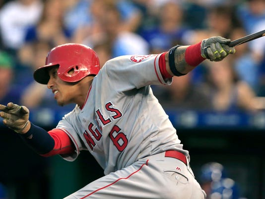 Los Angeles Angels' Yunel Escobar hits into a fielder's choice that scored Jett Bandy during the fifth inning of a baseball game against the Kansas City Royals at Kauffman Stadium in Kansas City, Mo., Wednesday, July 27, 2016. (AP Photo/Orlin Wagner)