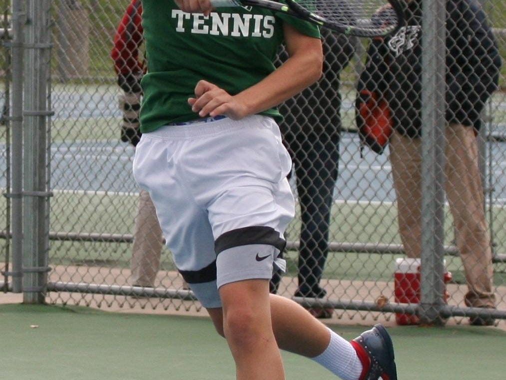 Oliver Weaver slams a forehand in the Division 4 State Tennis Championships on his way to the singles title Oct. 15.