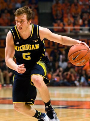 Michigan Wolverines guard Spike Albrecht (2) drives to the basket against the Illinois Fighting Illini at State Farm Center.