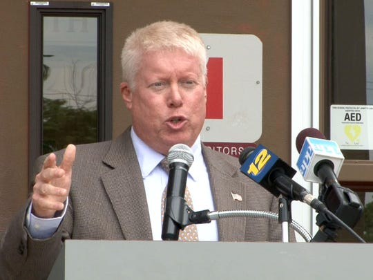 Brick Township Mayor John Ducey speaks about funding cuts during a news conference held outside Toms River High School South in June.