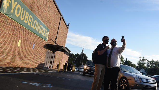 St. Mary Catholic Central High School president Sean Jorgensen takes a selfie with his son, junior Owen Jorgensen, after he arrived for the first day of school Aug. 18.