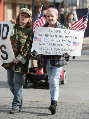 Veterans receive thanks during a Veterans Day parade in Richmond.