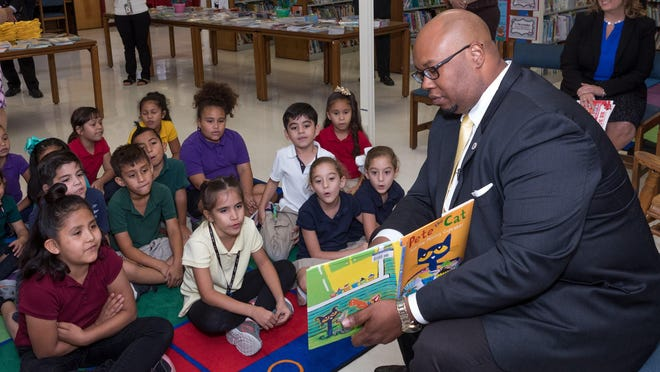 Schools Superintendent Donald Fennoy reads Pete the Cat and the Missing Cupcakes to first grade students at Forest Hill Elementary School in this 2018 photo.