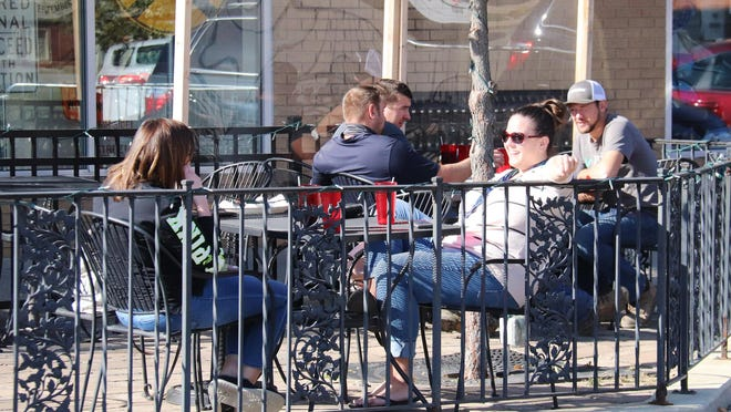 Thursday was the first day that stricter mitigations were in place for Region 2, which includes Livingston County, but the weather cooperated enough to allow for a pleasant outdoor-dining experience, as these patrons of DeLong's can attest.