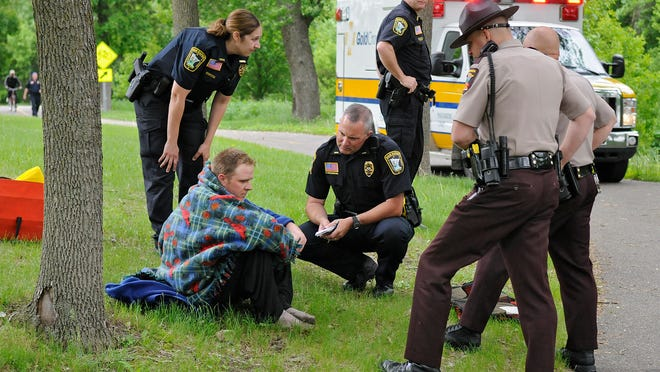 Officers talk with Lucas Bialke, who jumped into the Mississippi River from the Sauk Rapids Bridge Thursday.