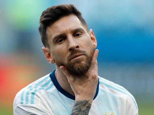 Argentina's Lionel Messi strokes his beard prior a Copa America Group B soccer match against Qatar at Arena do Gremio, Porto Alegre, Brazil, Sunday, June 23, 2019. (AP Photo/Victor R. Caivano)