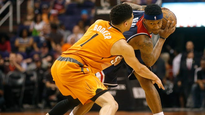 Phoenix Suns rookie Devin Booker guards Washington Wizards Bradley Beal during a game at Talking Stick Resort Arena in Phoenix on April 1, 2016.