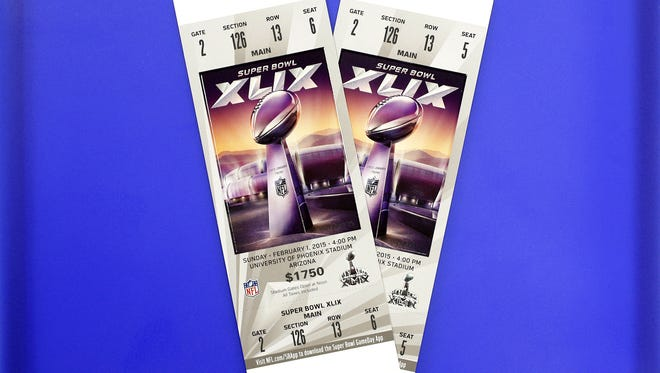 These are Super Bowl tickets for the Feb. 1, 2015, Super Bowl at the University of Phoenix Stadium in Glendale. This image has been altered to remove the ticket number and bar code for security/anti-counterfeiting purposes.