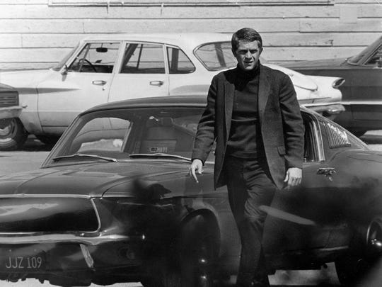 "Steve McQueen, starring in the title role of ""Bullitt,"" steps out of the Mustang after a 140 m.p.h. pursuit through the hilly streets of San Francisco."