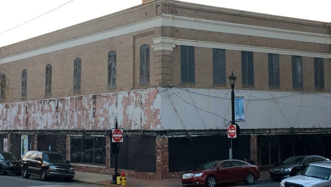 Two entities have submitted proposals to redevelop the threatened Weiss and Goldring building in downtown Alexandria.