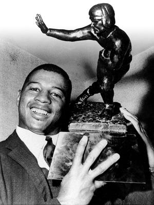 Ernie Davis with the Heisman Trophy he won in 1961 as the nation's outstanding college football player.