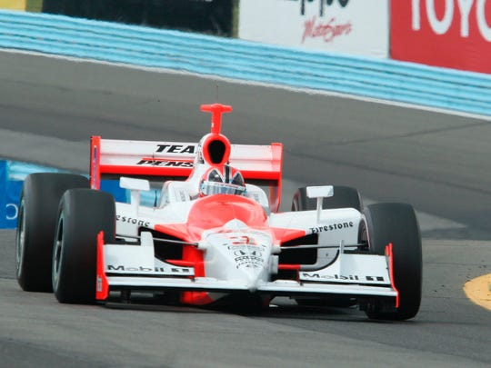 Helio Castroneves comes through the Esses during the Camping World Watkins Glen Grand Prix at Watkins Glen International in 2007.