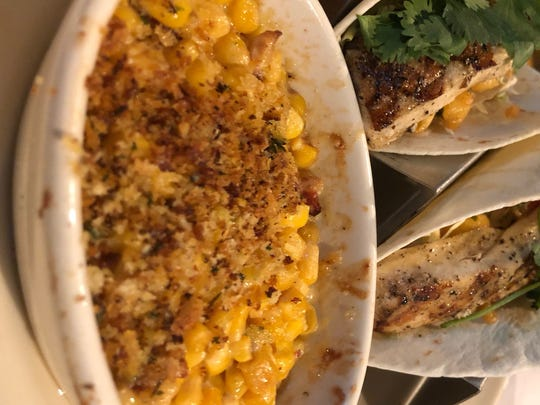 The Spicy Fish Tacos come with a side of baked cream