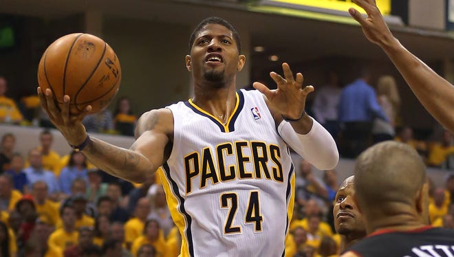 Indiana PacersÕ Paul George (24) goes to the basket with a shot during the first half of action. The Indiana Pacers hosted the Miami Heat in Game 5 of the NBA Eastern Conference Finals Wednesday, May 28, 2014, at Bankers Life Fieldhouse in Indianapolis.
