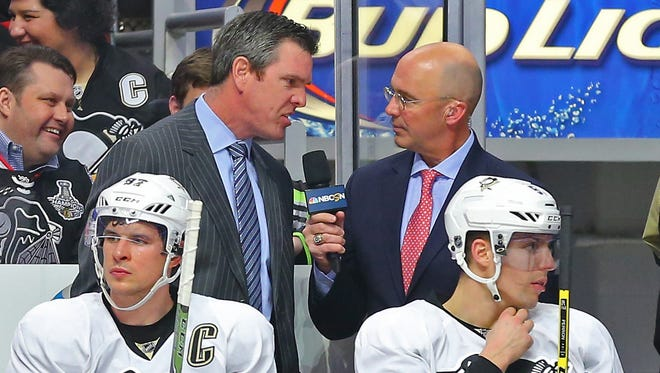 "NBC's ""Inside the Glass"" analyst Pierre McGuire talks with Pittsburgh Penguins head coach Mike Sullivan during the second period against the Chicago Blackhawks at United Center."