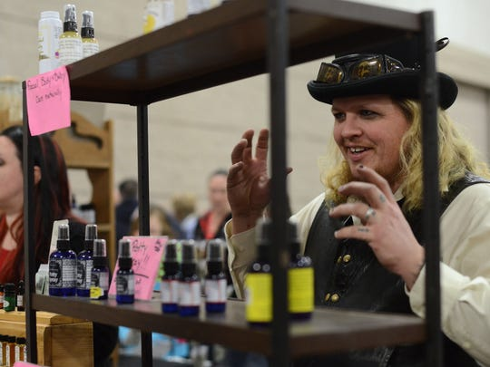 BOTTOM RIGHT: Kevin Adlebush talks with a passerby about the products offered Saturday at Aurora's Apothecary at the New Leaf Farmer's Market in the KI Convention Center.