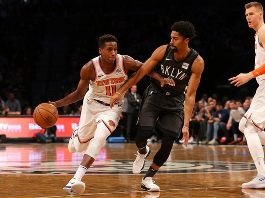 New York Knicks point guard Frank Ntilikina (11) controls