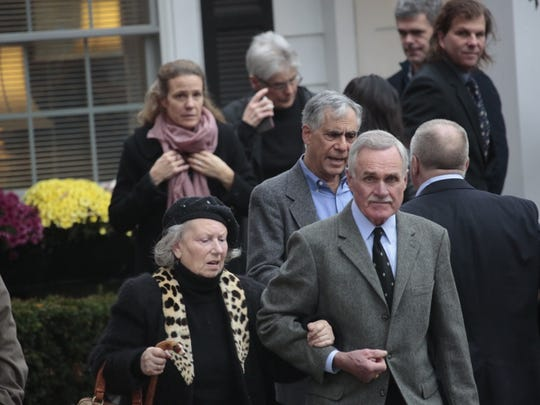 Mourners leave the Clark Funeral Home in Katonah for