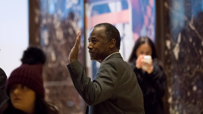 Ben Carson waves as he leaves  Trump Tower, Nov. 22, 2016 in New York City.
