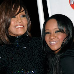 According to reports, Bobbi Kristina Brown will be laid to rest next to her mother, Whitney Houston, on Monday.