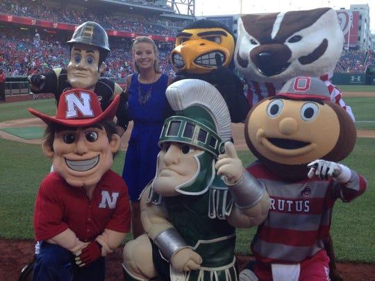WUSA9's Kristen Berset poses with Big Ten mascots at Nats Park on Monday, June 30, 2014.