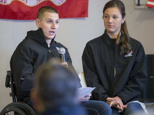 Zach and Kiley Nelson talk to neighbors and guests on Saturday, Jan. 9, 2016, about their new home in Noblesville, given to them by Homes for our Troops. Nelson, a Marine corporal, was paralyzed in a vehicle rollover in Afghanistan in 2012.