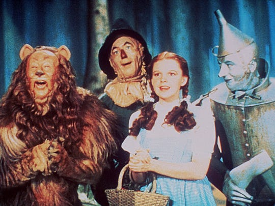 "Scene from the MGM classic film ""The Wizard of Oz."" From left, Burt Lahr, Ray Bolger, Judy Garland and Jack Haley."