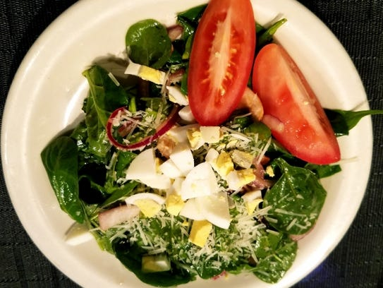 1120 Prime's spinach salad was topped with red onion,