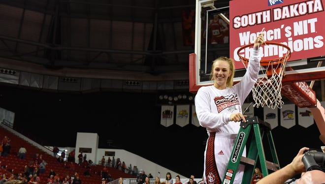 USD's #35 Nicole Seekamp celebrates with her team and fans after winning the WNIT championship game against FGCU at the DakotaDome in Vermillion, S.D., Saturday, April 2, 2016.
