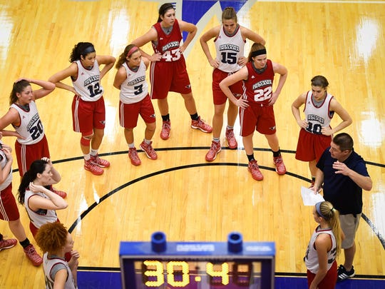 University of Southern Indiana women's basketball head coach Rick Stein assembles his team at the top of the key as they prepare for the Great Lakes Valley Conference men's and women's basketball tournament, during practice Tuesday, February 28, 2017.