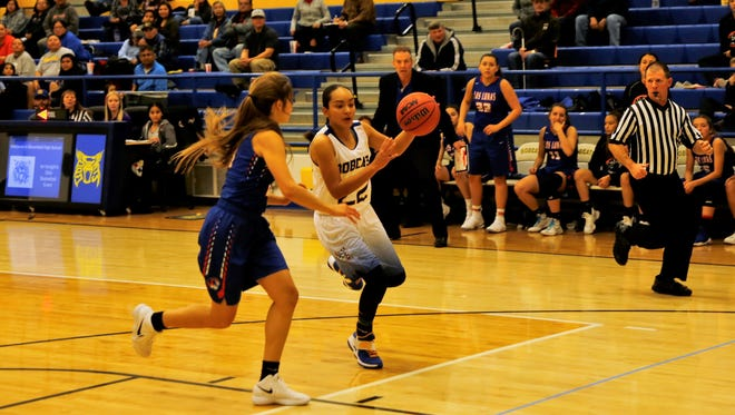 Bloomfield's Brandi Alcantar steals the ball and drives to the basket for a layup against Los Lunas on Thursday, Nov. 30 at Bobcat Gym.