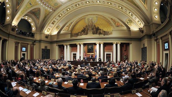 Minnesota Gov. Mark Dayton addresses a joint session of the Legislature.