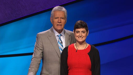"""In this Aug. 31, 2016 photo provided by Jeopardy Productions, Inc., Cindy Stowell, right, appears on the """"Jeopardy!"""" set with Alex Trebek in Culver City, Calif. Stowell, who died of cancer just days before her appearance on """"Jeopardy!"""" aired won six contests in a row and more than $103,000, some of which has been donated toward cancer research. Stowell's run ended when she finished second in her seventh appearance that aired on Wednesday, Dec. 21."""