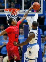 Dayton's Kostas Antetokounmpo blocks a shot against Rhode Island last season.
