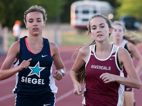 Riverdale's Emma McClellan, right, won the 1,600-meter