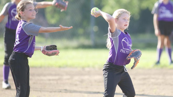 Creations by Diana shortstop Mikayla Bohlken gets some help from teammates as to where to throw the ball in Babe Ruth 8U softball Thursday night against Glasgow Lady River Rats at Lions park.