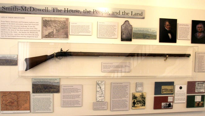 "Daniel Smith rifle, ""Long Tom,"" hangs in the Smith-McDowell House and Museum, which opens its famed Victorian Christmas exhibit and program series Nov. 18. Call 828-253-923 for more information."