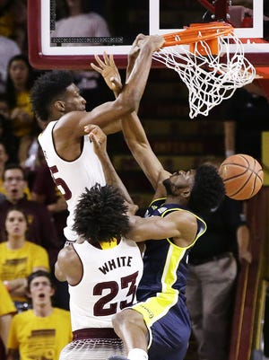 Arizona State forward De'Quon Lake dunks the ball over Northern Arizona forward Ruben Fuamba in the first half on Nov. 17, 2017 at Wells Fargo Arena in Tempe, Ariz.