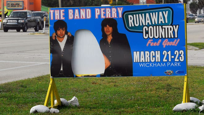 A bandit cut out Kimberly Perry's picture on a sign touting The Band Perry for last year's Runaway Country Space Coast Music Festival.
