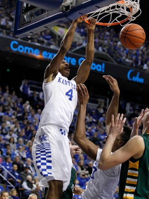 Kentucky Wildcats guard Charles Matthews (4) dunks the ball against the Wright State Raiders in the first half at Rupp Arena.