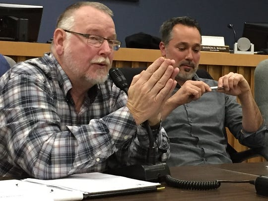 Councilman Herb Doloway, left, makes a point during a curb and sidewalk committee meeting Thursday. Doloway is vice chairman of the committee. Next to him is Jeremy Cate, a council member and the committee's chairman.
