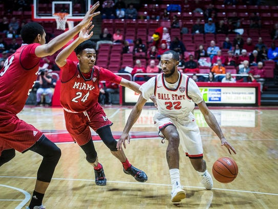 Ball State's Jeremie Tyler dribbles past Miami's defense