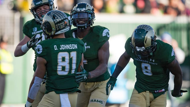 CSU receiver Bisi Johnson celebrates with his teammates after scoring a touchdown in the Rams' 42-14 win over San Jose State on Nov. 18 at CSU's on-campus stadium.