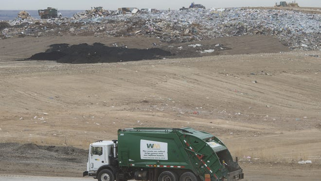 A truck carrying material from residential pick-ups enters the dumping area at the Larimer County Landfill on Wednesday, January 10, 2018.